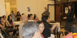 The audience listens to Dr. Padilla