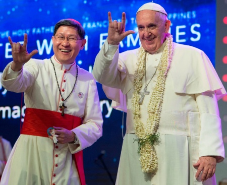 Pope Francis and Cardinal Tagle gesture during meeting with families in Mall of Asia Arena in Philippines